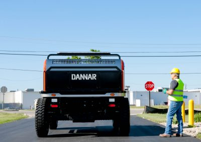 DANNAR 400 pictured with operator at a street sign